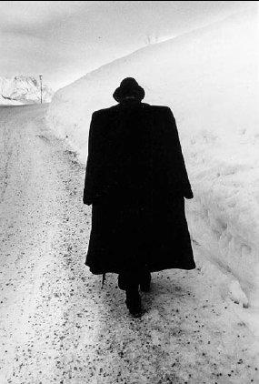 man-walking-in-snow
